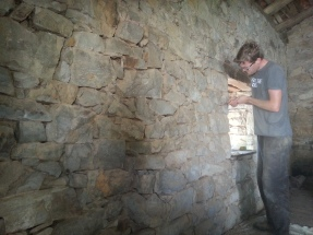Dave picking out old mortar