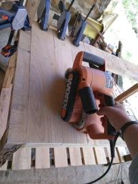 Sanding the worktop planks